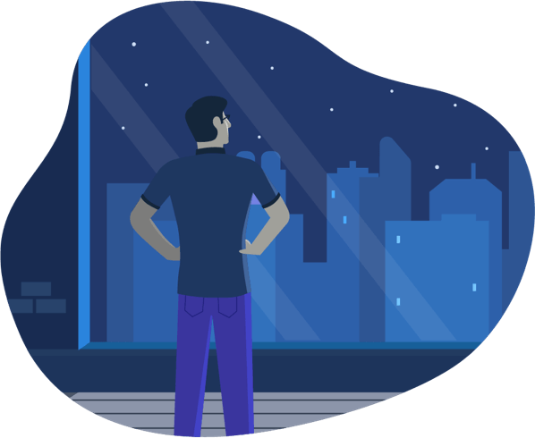Man looking out a window at night